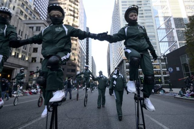 parade giraffe riders